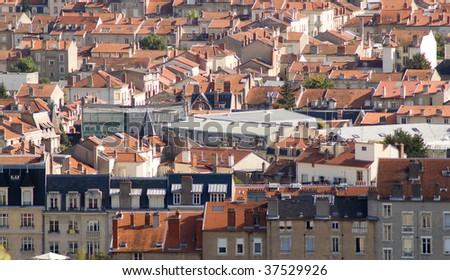view of some houses in the neighborhood - stock photo