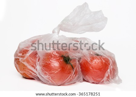 View of some tomato inside a plastic bag isolated on a white background.