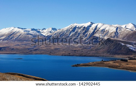 View of Southern Alps from Lake Tekapo - stock photo