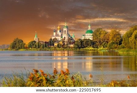 View of Spaso-Yakovlevsky Monastery in Rostov Veliky from Nero's lake on a sunset - stock photo