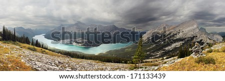 View of Spray Lake while hiking down the slope of Windtower Peak Summit, Near Canmore, Alberta, Canada. Mount Rimwall can be seen on the far right. - stock photo
