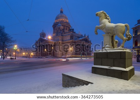 View of St. Isaac's Cathedral and sculpture of the Dioscuri at Horse Guards Manege in St. Petersburg - stock photo