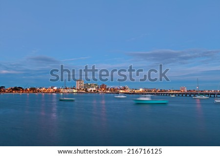 View of St. Kilda suburb from the pier, with boats in the harbor - stock photo