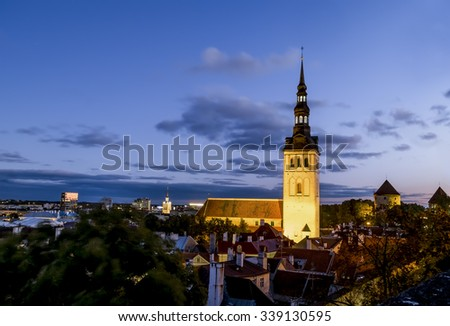 View of  St Nicholas Church  in old Tallinn at evening illumination . Estonia - stock photo