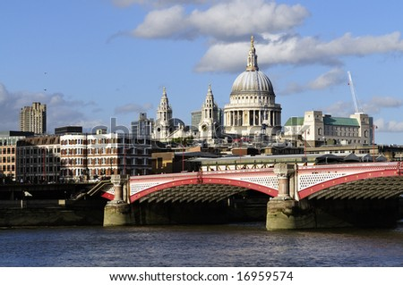 View of St Paul's Cathedral from the South Bank, with Blackfriar's Bridge and the River Thames in the foreground, taken late on a summer afternoon. - stock photo
