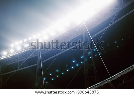 View of stadium lights at night - stock photo