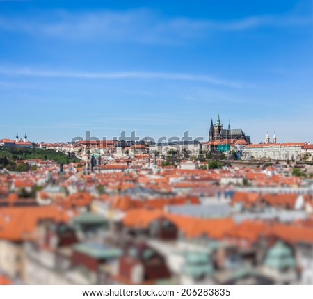 View of Stare Mesto (Old City) and and St. Vitus Cathedral from Town Hall with tilt shift toy effect shallow depth of field. Prague, Czech Republic - stock photo
