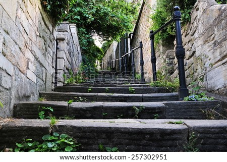 View of Steps Leading up a Narrow Alleyway - stock photo