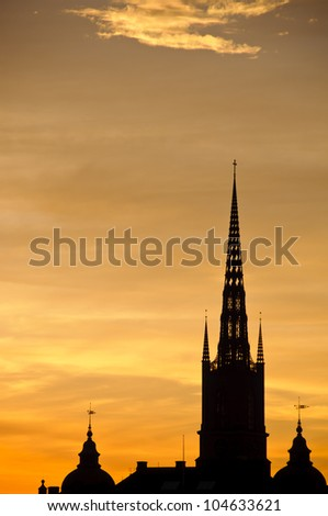 View of Stockholm old town and Riddarholmen church tower at sunset - stock photo