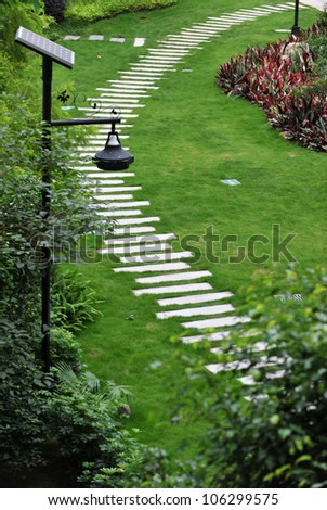 view of stone path in garden. - stock photo