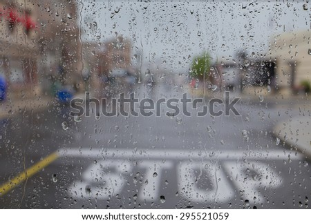 view of stop on the street on a rainy day. - stock photo