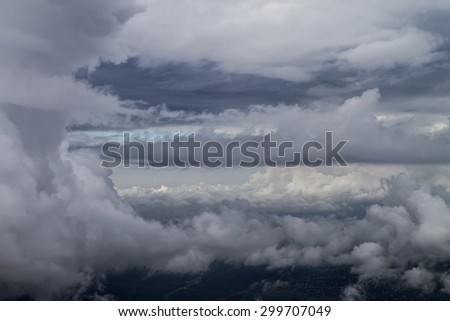 view of storm clouds from airplane window - stock photo