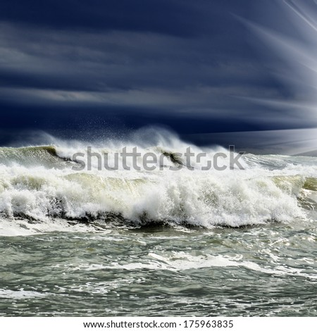 View of storm seascape and sun ray through clouds - stock photo