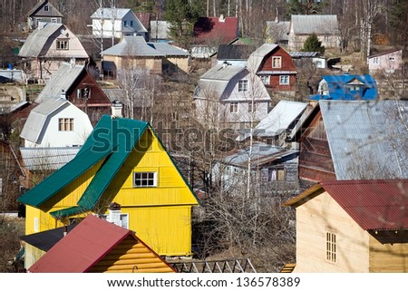 view of suburb settlement in Russia with small wooden houses - stock photo