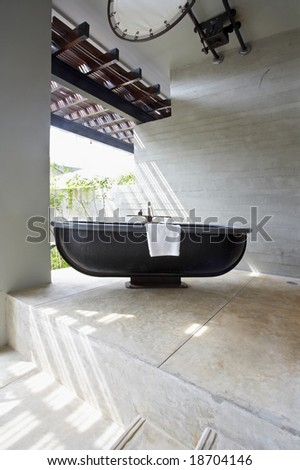 View of summerhouse terrace with black bath in a middle - stock photo