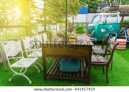 View of sun light on empty outdoor cafe table at park, Set up table in a restaurant - stock photo
