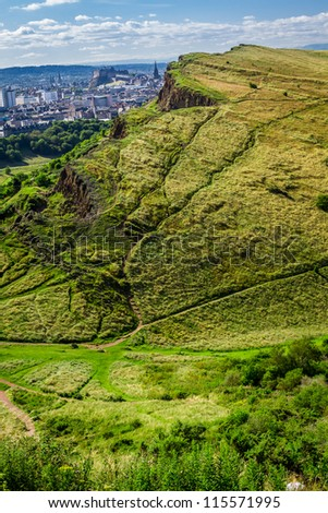 View of sunny Edinburgh from the top of Arthur Seats in summer - stock photo