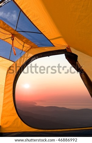 view of sunrise from a touristic tent - stock photo