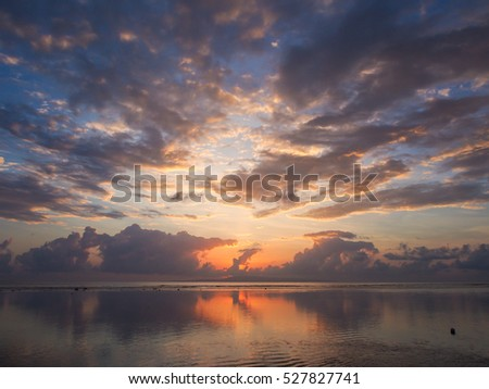 View of sunrise in the morning with sea horizon. Nice view of sky changing from blue to orange