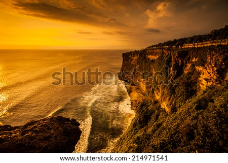 view of sunset at cliff in Bali Indonesia. - stock photo
