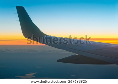 View of sunset from airplane window - stock photo
