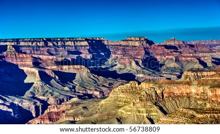 View of sunset from the South Rim in Grand Canyon, National Park. The Grand Canyon is a steep-sided gorge carved by the Colorado River in the United States in the state of Arizona. - stock photo