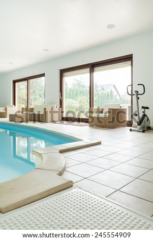View of swimming pool in modern house - stock photo