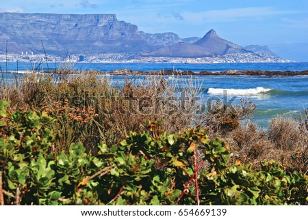 View of Table Mountain, Lions Head and Signal hill  from across the ocean
