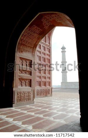 View of Taj Mahal minaret from inside Mosque, Agra, India - stock photo