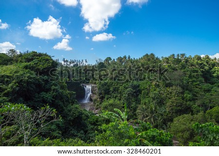 View of Tegenungan waterfall, it is one of the many tourist places and destination in Bali, Indonesia. About 5 km southeast from Ubud. - stock photo