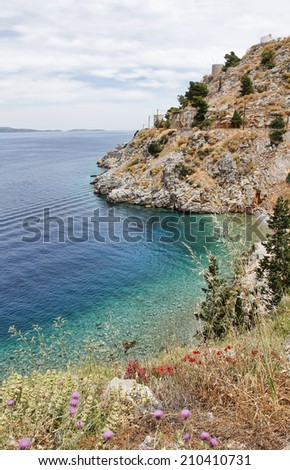 View of the Aegean Sea and Hydra island with windmill in Greece. - stock photo