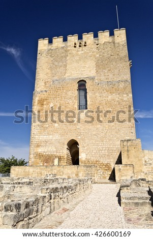 View of the Alcazar tower of homage inside the Fortaleza de La Mota near the town of Alcala la Real, Spain - stock photo