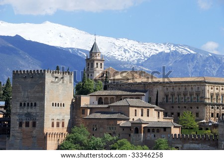 View of the Alhambra palace in the late afternoon with the Sierra Nevada mountains in the background.This is an UNESCO World Heritage site. - stock photo