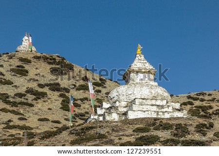 View of the ancient Buddhist stupa near Dingboche valley - Everest region, Nepal, Himalayas - stock photo