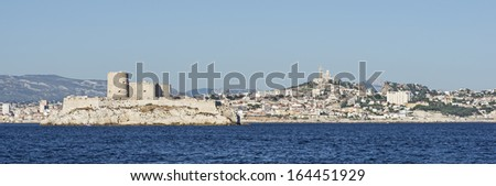 View of the ancient castle Chateau dIf and the city of Marseille in France - stock photo