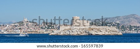 """View of the ancient castle """"Chateau dIf"""" and the city of Marseille in France - stock photo"""