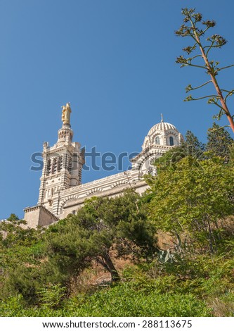 View of the ancient church Notre Dame de la Garde of Marseille in France from the South - stock photo