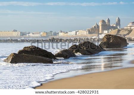 View of the ancient city of Cadiz. Big stones on the shore of Atlantic Ocean. Spain in winter - stock photo