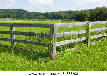 View of the ancient wooden fence on the farm. - stock photo