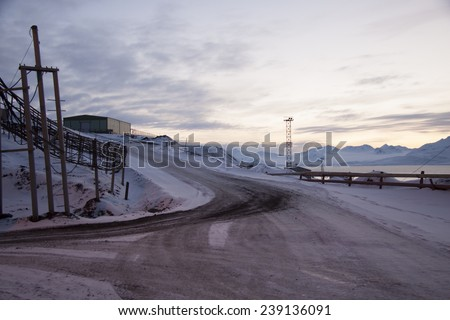view of the area of the Russian settlement Barentsburg on Spitsbergen at the beginning of the polar night - stock photo