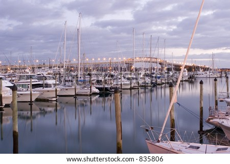 View of the Auckland Harbour Bridge from Westhaven Marina - stock photo