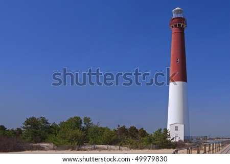 View of the Barnegat Lighthouse from the walkway - stock photo
