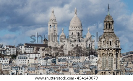 View of The Basilica of Sacre-Coeur (Montmartre) from a survey terrace of Gallery Lafayette,Paris.