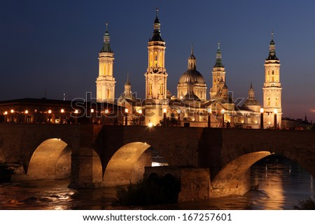 View of the basilica of the Virgen del Pilar and Ebro river, on the right is located the medieval bridge called Puente de Piedra, Zaragoza, Aragon, Spain