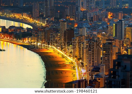 View of the beach at night background coastal city (Spain, Benidorm) - stock photo