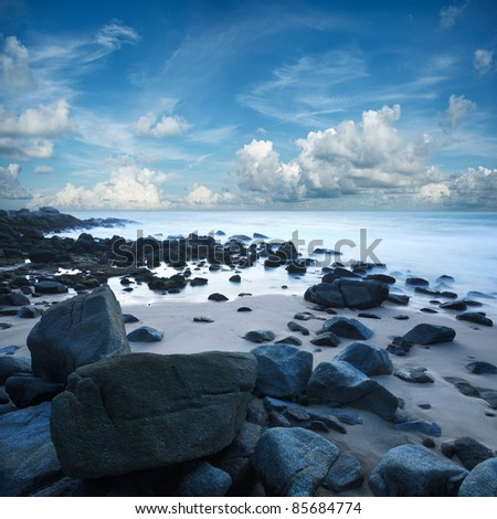 View of the beach at Singh cape. Phuket island, Thailand. Long exposure shot. - stock photo