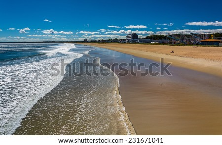View of the beach from the pier at Old Orchard Beach, Maine. - stock photo