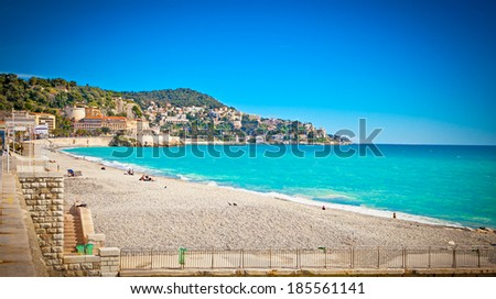 View of the beach in Nice, near the Promenade des Anglais, on summer hot day, France. - stock photo