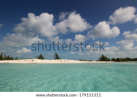 View of the beautiful clean ocean on the coast with a sky full of clouds - stock photo
