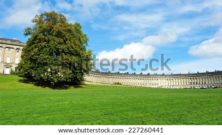 View of the Beautiful Georgian Era Royal Crescent and Victoria Park in Bath in England - The Park and Crescent are a Famous Landmark in the Somerset City - stock photo